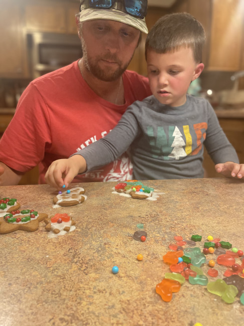 Weekends during December are filled with lots of cookie making. This is serious business to this four year old. His little brother doesn't care what they look like as long as they taste good.