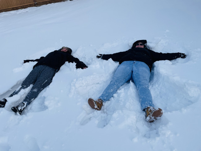 My mom and I making snow angels. You're never to old to enjoy the snow.