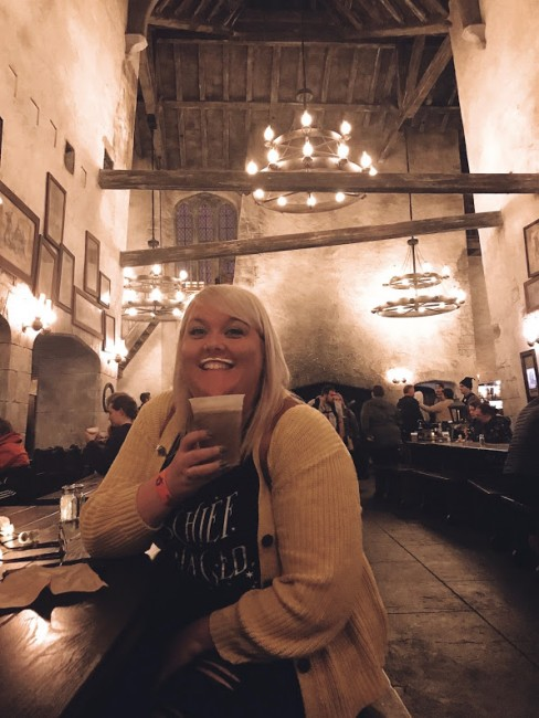 Enjoying some Butterbeer at the Three Broomsticks in the Wizarding World of Harry Potter.