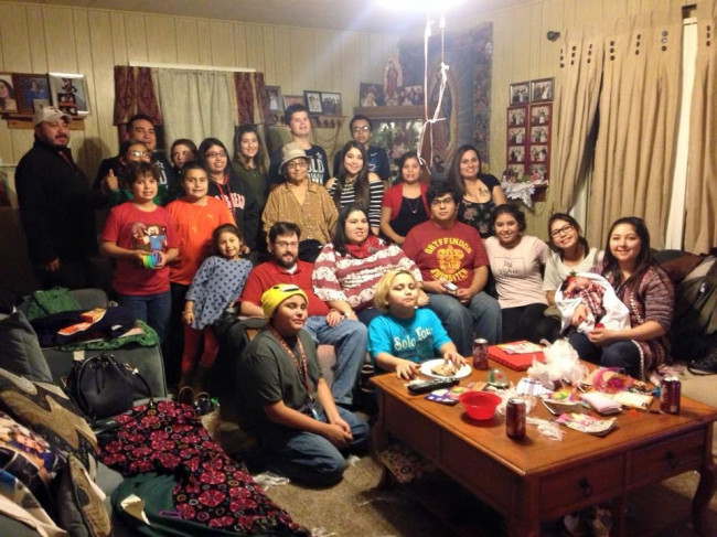 This picture was taken two Christmas's ago at Amanada's grandmother's house. This is a picture of grandkids and great grandkids that were in attendance. There's much more of us -more like 97!