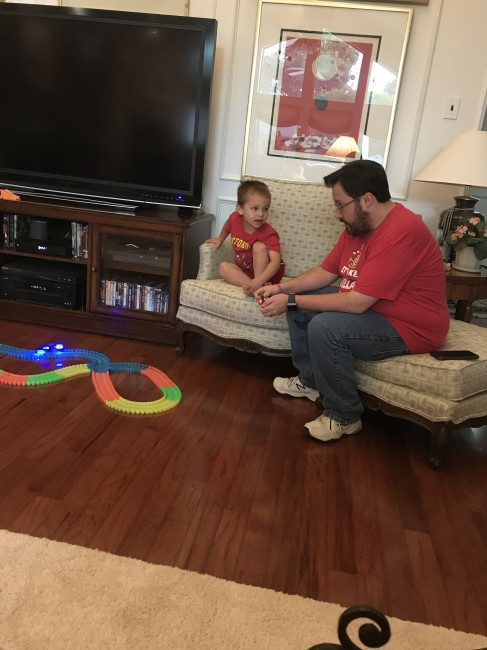 Wyatt showing our young nephew how to use his new race track