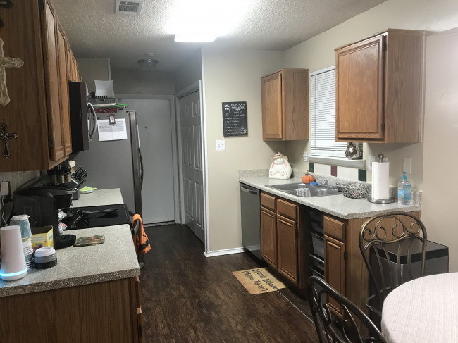 Our kitchen is a very spacious galley style that allows us to cook together which was something that was somewhat difficult to do in our townhome.