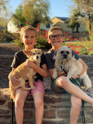 Whitney's dad is a veterinarian, and he has passed on a love of animals to all of his family. The boys love playing with and caring for their dogs-- Lizzy and Noodle. They learned at a very early age  how to be gentle to animals.