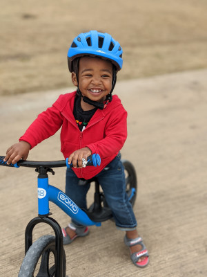 We love to be outside any chance we get! Micah loves to go on walks, riding his bike, and playing at the park!