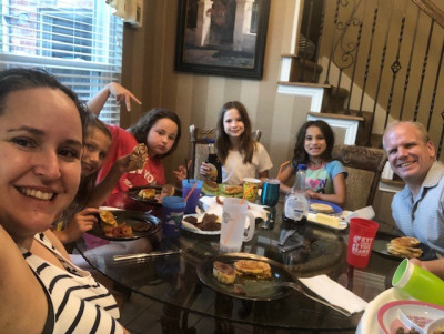 We always eat dinner together at the dinner table and no one can eat until we all hold hands and say grace. We especially love having friends over for dinner, too.