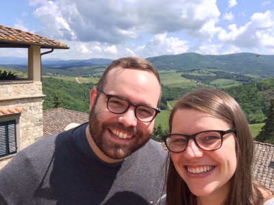 We love to travel!  This is us overlooking beautiful Tuscany, Italy.
